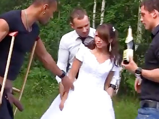 Russian one of a pair enjoys an interracial gang-bang outdoors
