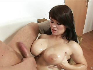 Oiled back MILF Kristi Love gets her huge tits cum covered