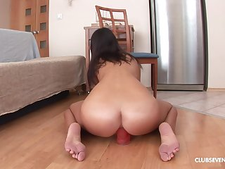 passionate brunette Claire H ramming a big and fat dildo first of all the stupefy