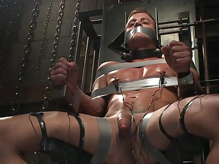 Clamped gay man roughly fucked after a venal oral