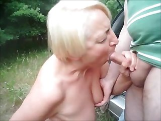 Granny dogging and sucking unknown dick outdoor