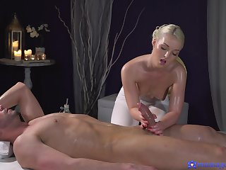 Aroused blonde jerks guy's dick in imbecilic modes then sucks hard