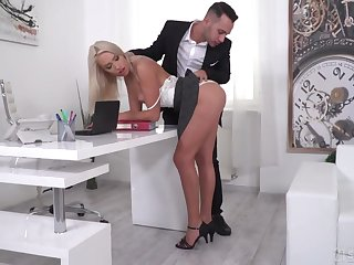 Young and handsome boss and his assistant fuck pretty leggy blonde in both holes