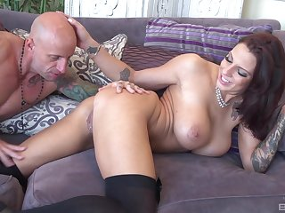 Busty bombshell Lilith Lavey rides cock with respect to the brush legs apart